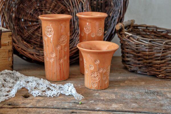 Vase hoch mit Blumen, orange